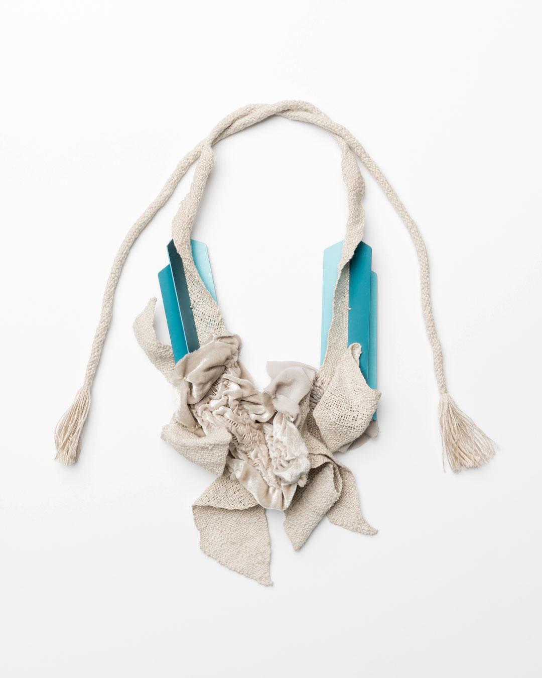 Ineke Heerkens, Many Sensations, 2017, necklace; linen, silk-velvet, anodised aluminium, 400 x 170 x 55 mm, €3200