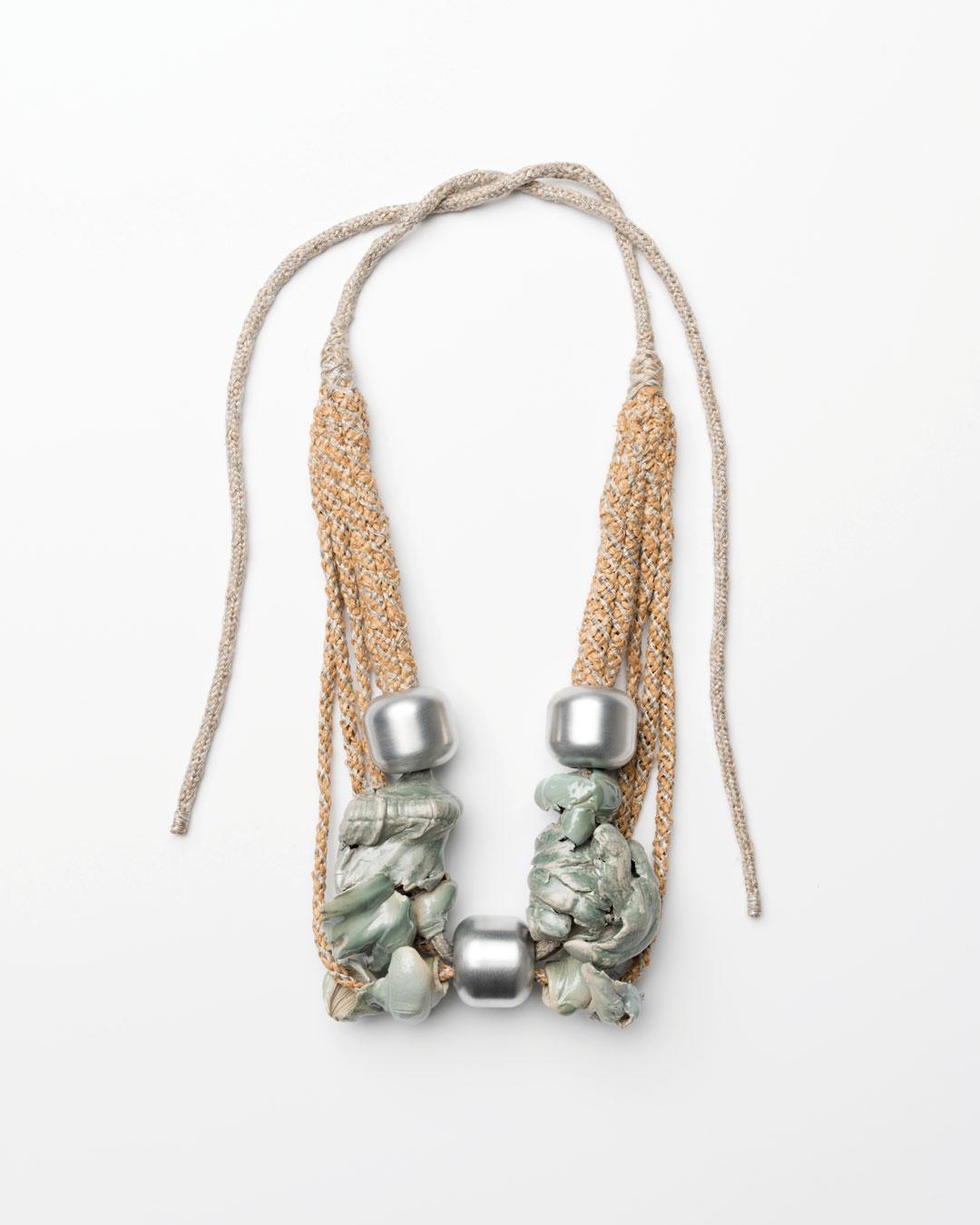 Ineke Heerkens, Everybody Go Up, 2017, necklace; linen, synthetic silk, raffia, banana leaf, aluminium, ceramic, glaze, lustre, 340 x 160 x 60 mm, €2500