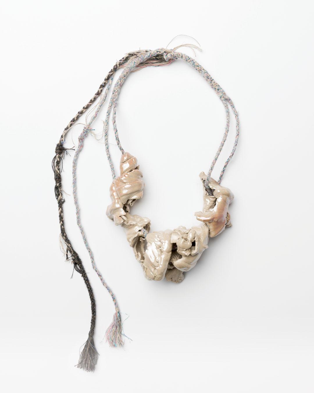 Ineke Heerkens, Accidental Curiosity, 2017, necklace; linen, cotton, lurex, wool, silk, ceramic, glaze, iris lustre, 360 x 175 x 70 mm, €2100