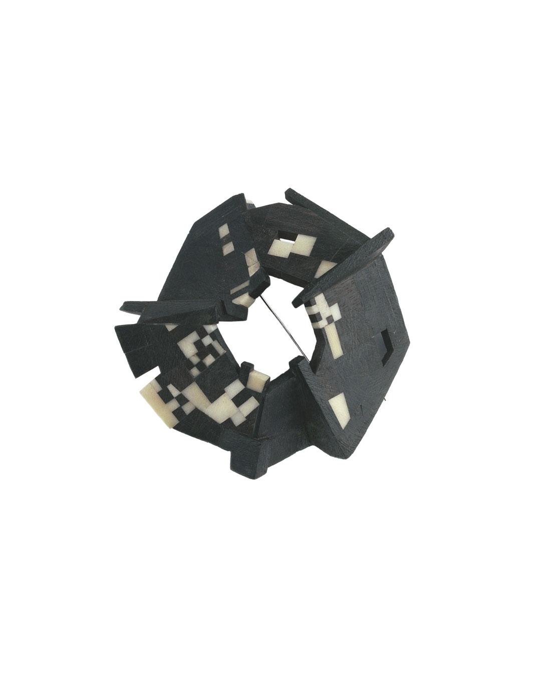 Ann Schmalwasser, Spirale (Spiral), 2008, brooch; ebony, tagua nut, 90 x 90 x 40 mm, €1650