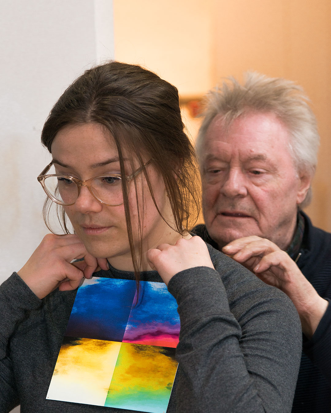 Astrid Ubbink and Robert Smit fitting a necklace