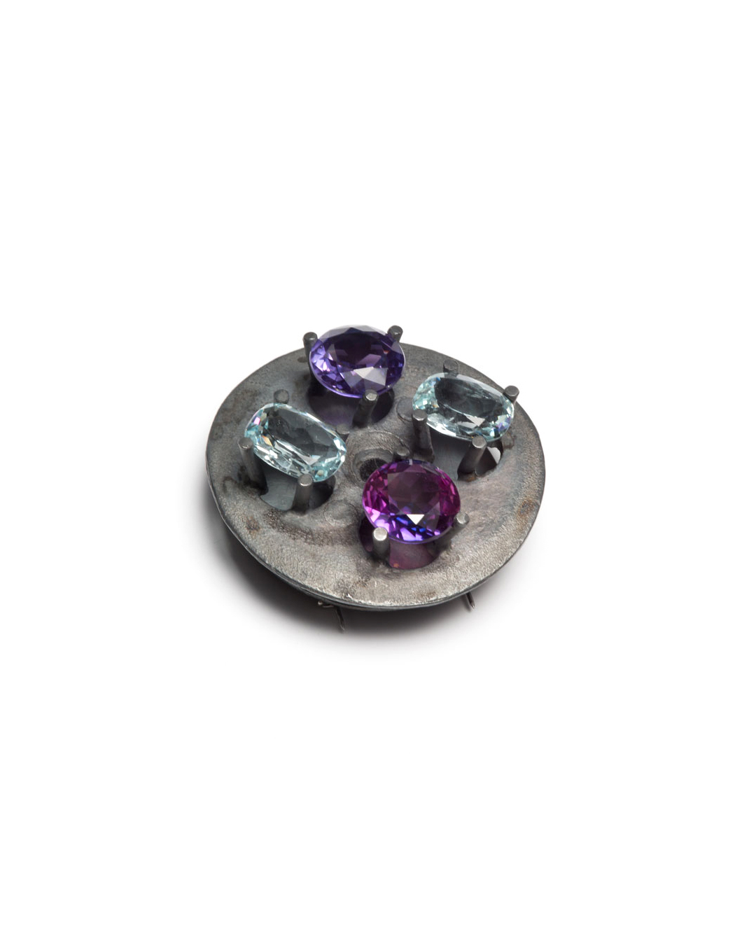 Winfried Krüger, untitled, 1993, brooch; oxidised silver, aquamarine, amethyst, kunzite, ø 55 mm, €3650