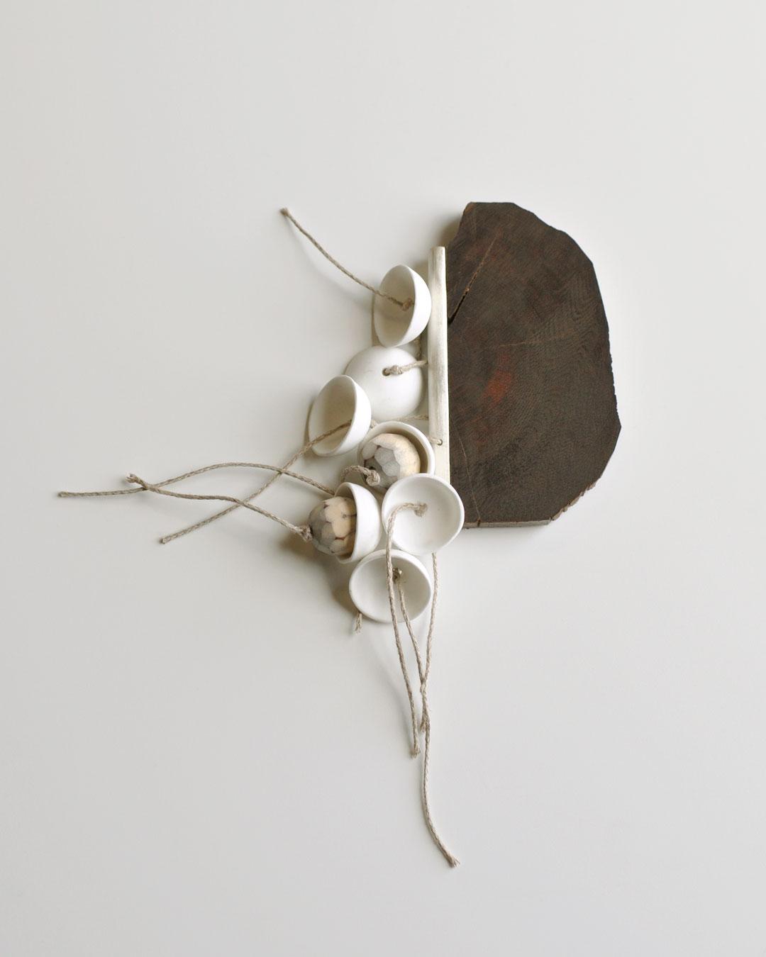 Chequita Nahar, Switi Watra, 2010, brooch; snakewood, porcelain, pine, silver, cord, 110 x 140 x 280 mm, €950