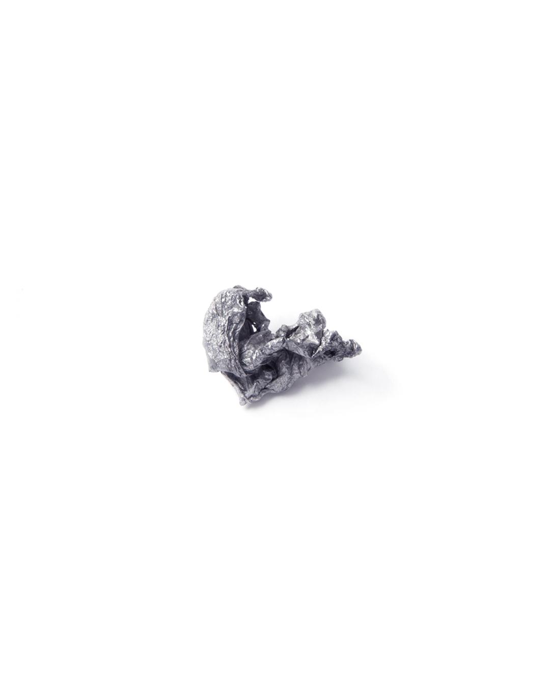 Barbara Schrobenhauser, Burnt Secret, 2015,  brooch; aluminium, stainless steel, 35 x 25 x 20 mm, €390