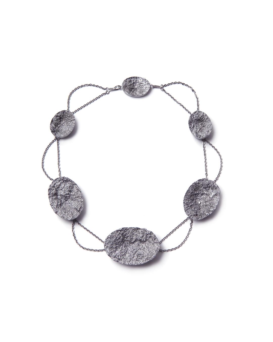 Barbara Schrobenhauser, Surfaces, 2015, necklace; aluminium, stainless steel, silver, 490 x 12 mm, €1575
