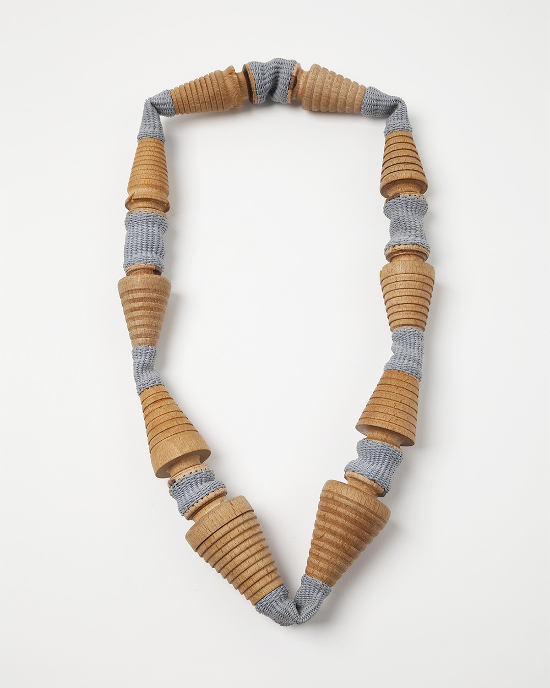 Barbara Schrobenhauser, Spules, 2020, necklace; wood, woven string